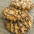 Chocolate chip cookies on wooden table (selective focus) — Stock Photo