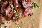 Smoked sausage with rosemary — Stock Photo