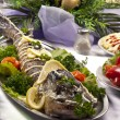 Pike prepared fish and some salads behaind — Stock Photo