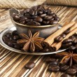 Coffee beans in a silver cup with smoke — Stock Photo