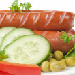 Close up of sausage and fresh vegetables — Stock Photo