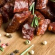 Smoked sausage with rosemary and peppercorns — ストック写真