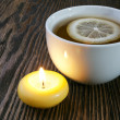 Hot tewith lemon and candle — Stock Photo #36947067
