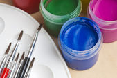 Paint buckets and brush — Stock Photo