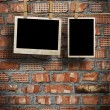 Pictures on a rope with clothespins, with clipping path for images, in front of a brick wall — Stock Photo