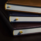 Close-up of a few colored books notebooks, diaries — Stock Photo
