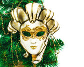 Christmas decoration with tree and carnival mask on a white background — Stock Photo