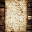 Stock Photo: Old paper on wood background