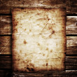 Old paper on the wood background — Stock Photo #37984207