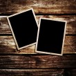 Old blank photos frames lying on a wood surface for text and photo — Stock Photo