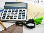 Calculator on paper table with diagram — Stock Photo