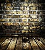 Interior com parede de tijolo — Fotografia Stock