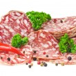 Sliced salami isolated on white — Stock Photo
