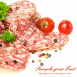 Stock Photo: Sliced salami isolated on white