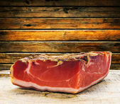 Parma ham on a wooden board — Stock Photo