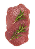 Beef with sprig of rosemary — Stock Photo