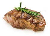 Beef steak with rosemary — Stock Photo