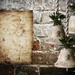 Bells and old paper on brick wall — Stock Photo #44023675