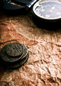 Coins and compass — Stock Photo
