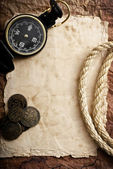 Compass, coins and rope — Stockfoto