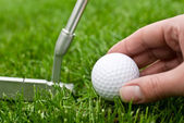 Ball and a putter — Stock Photo