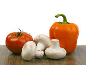 Mushrooms, peppers and tomatoes — Stock Photo