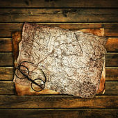 Old glasses on the vintage map — Stockfoto