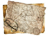 Old glasses on the vintage map — Zdjęcie stockowe
