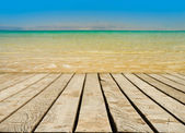 Wooden pier with blue sea — Foto Stock