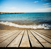 Wooden pier with blue sea — Stock Photo