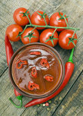 Ketchup with pepper and tomatoes — Stock Photo