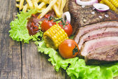 Beef steaks with french frie  and  vegetables — Stock Photo
