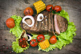Beef steaks with vegetables — Stock Photo