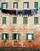 Underwear drying on the wall of the house — Stock Photo