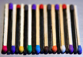 Black and white Match sticks with colored heads — Stock Photo