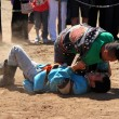 INNER MONGOLIA, CHIN- JULY 14: Mongoliyoung men wrestling in steppe near Hohhot — ストック写真 #38648657