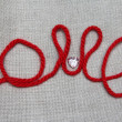 "Word ""love"" from red thread and a button in the form of heart — Stock Photo #39050129"