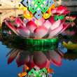 Stock Photo: Lotus and endless knot, buddhist festive decoration on lake