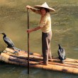 YANGSHUO, CHINA - NOV 5: Chinese woman on a bamboo raft on the L — Stock Photo