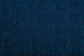 Material into small, blue grid, background — 图库照片