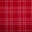 Material into grid, a textile background. — Stock Photo