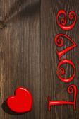 The red heart and the inscription, a background — Stok fotoğraf