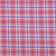 Material into grid, a textile background — Stock Photo #38136693