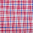 Material into grid, a textile background — Stock Photo