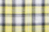 Material into grid, a textile background — Foto de Stock
