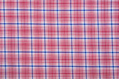Material into grid, a textile background — Stockfoto