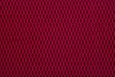 Maroon material, a background — Stockfoto