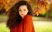 Beautiful girl in red dress in forest — Stock Photo