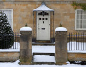 House doorway with snow — Stok fotoğraf