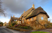 Thatched stone cottage, England — Stock Photo